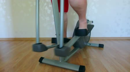 bisiklete binme : overweight woman legs exercising on trainer ellipsoid