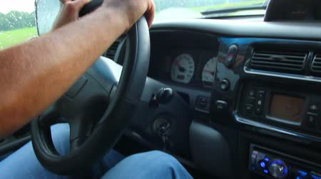 rpm : mans hand driving in car close-up