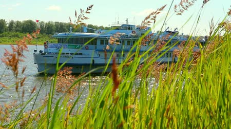 rzeka : passenger ship floating in river