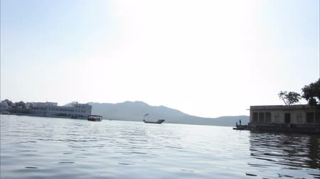 pichola : timelapse view from boat on lake and palaces in Udaipur India