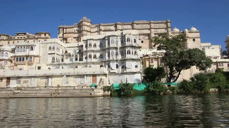 pichola : view from boat on lake and palaces in Udaipur India Stock Footage