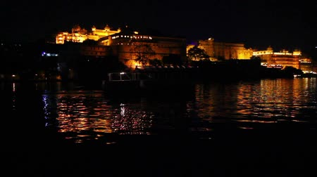 pichola : palace on lake in Udaipur India at night Stock Footage