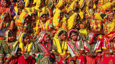 editorial : Indian girls in colorful ethnic attire at Pushkar camel fair India