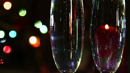 şarap cam : glasses with champagne and candle against festive lights background