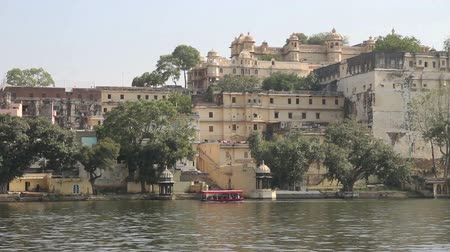 asian and indian ethnicities : Pichola lake and palaces in Udaipur India