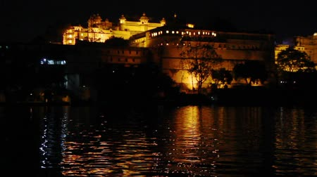 pichola : palace on lake in Udaipur at night - India Stock Footage