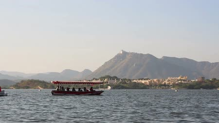pichola : boat floating on Pichola lake in Udaipur India