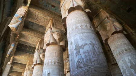 womanhood : Interior of the painted and carved hypostyle hall at Dendera Temple. Ancient Egyptian temple near Qena. Pan view Stock Footage