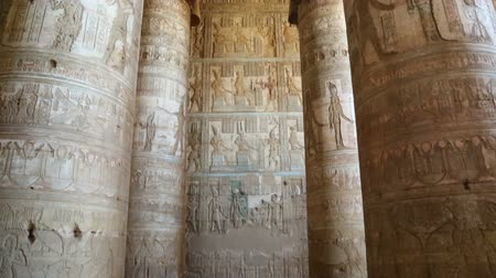 womanhood : Interior of the painted and carved hypostyle hall at Dendera Temple. Ancient Egyptian temple near Qena. Tilt view