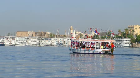 nil : LUXOR, EGYPT - DECEMBER 5, 2014: Touristic boat on Nile river in Luxor, Egypt