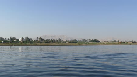 aswan : Nile river landscape - view from boat 4k