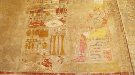 sarcophagus : ancient egypt color images on wall in luxor - tilt view