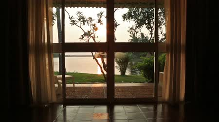 window room : View from the room window on the lake and sunset Stock Footage