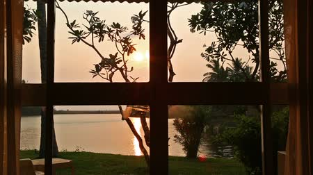 erkély : View from the room window on the lake and sunset Stock mozgókép
