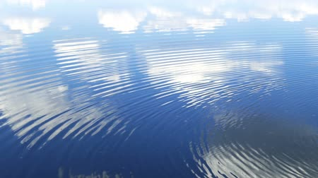 рябь : circles flow along surface of water, in water reflects sky with clouds