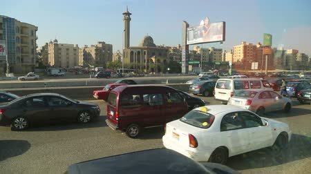 kahire : CAIRO, EGYPT - DECEMBER 01, 2014: View from the window of the bus on the streets of Cairo Stok Video