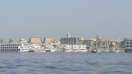 nil : view of Luxor from boat sailing on Nile river