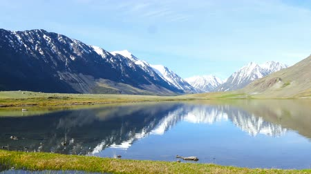 pans : mountain landscape with lake in Altay, Russia Stock Footage