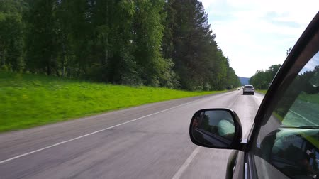asphalt road : Driving on road in car