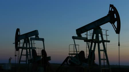 industry : working oil pumps silhouette in dusk, 4k