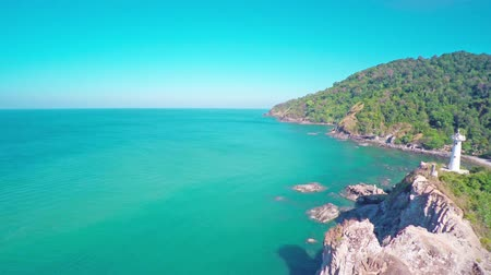 güney : Flying over the lighthouse on the south coast of Koh Lanta island, Krabi, Thailand, 4k
