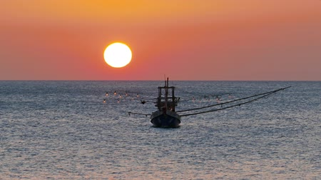 fishing industry : fishing boat in the sea against the backdrop of the setting sun, 4k Stock Footage