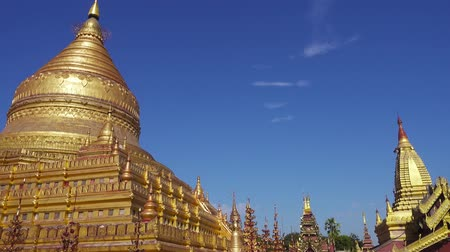 nyaung u : BAGAN, MYANMAR - JANUARY 25, 2016: The golden Shwezigon Pagoda (Shwezigon Paya) in Bagan, Myanmar (Burma), pan view