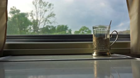 çay fincanı : cup holder on the table near window in the moving train Stok Video
