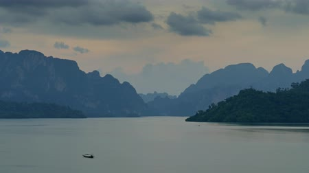 surat : Cheow Lan Lake at sunset, Khao Sok National Park in southern Thailand, timelapse