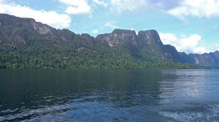 surat : View from boat on Cheow Lan lake in National Park Khao Sok, Thailand Stock Footage