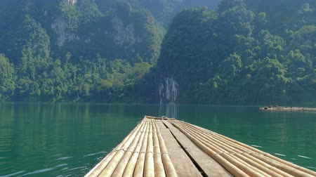 surat : Bamboo rafts on Cheow Lan lake, National Park Khao Sok, Thailand