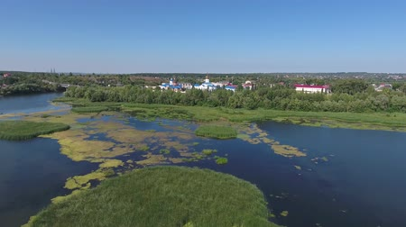volga region : Aerial view on church in Syzran city, placed on Volga river, Russia, 4k