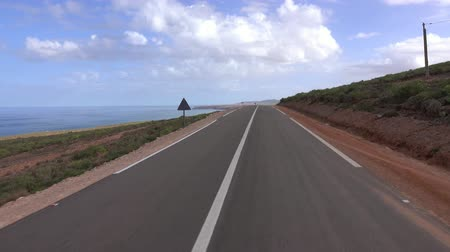 lengthy : View from a car driving on the road along the Atlantic coast, Morocco, Africa, 4k Stock Footage