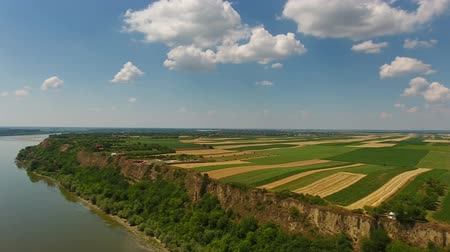 sérvia : Aerial view of colorful fields on high bank of Danube river in Serbia, panorama 4k Vídeos