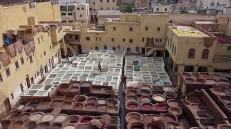 moribundo : Panorama of tanneries in Fes, Morocco, Africa. Old tanks with color paint for leather, 4k