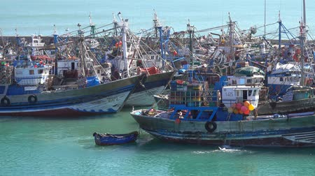 Fishing boats and yachts in port of El Jadida city in Morocco, Africa, 4k Stock mozgókép