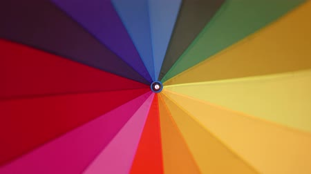 bas nylons : A multi-colored rainbow umbrella rotates around its axis, 4k