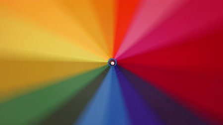 variegado : A multi-colored rainbow umbrella rotates around its axis, 4k