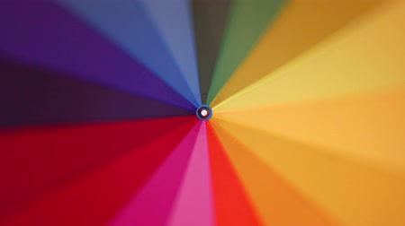 slunečník : A multi-colored rainbow umbrella rotates around its axis, 4k