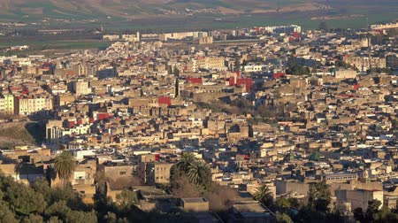 cami : Panorama view of the old Medina in Fes at sunset, Morocco (Fes El Bali Medina), 4k