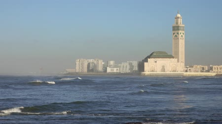mesquita : Hassan II mosque in Casablanca and Atlantic ocean waves at sunset, Morocco, panorama 4k