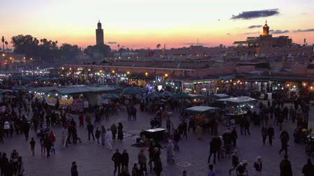 mesquita : Famous Jemaa el Fna square crowded after sunset, Marrakesh, Morocco, 4k