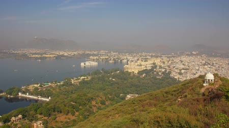 indian landmark : Landscape with lake and palaces in Udaipur, India, zoom in timelapse 4k