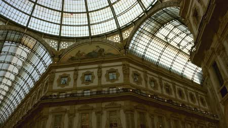 emanuele : MILAN, ITALY - CIRCA MAY, 2017: Interior of the Milano Galleria Vittorio Emanuele II gallery Lombardy, tilt view 4k Stock Footage