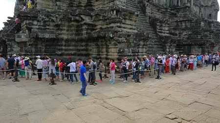 queue : SIEM REAP, CAMBODIA - CIRCA JAN 2017: A group of tourists in Angkor Wat. It is a temple complex in Cambodia and the largest religious monument in the world.