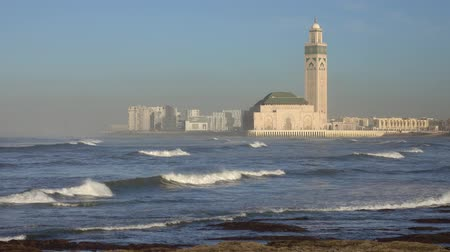 moroccan : Hassan II mosque in Casablanca and Atlantic ocean waves at sunset, Morocco, 4k Stock Footage