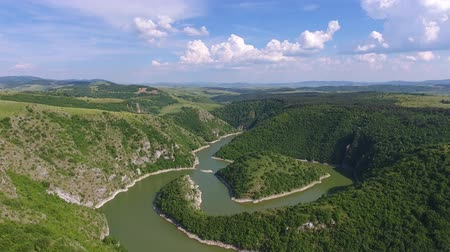 овраг : Aerial view of the rocky river Uvac gorge on sunny day, southwest Serbia, 4k