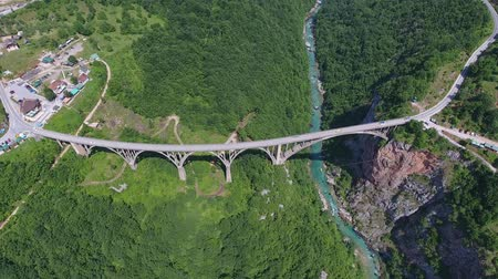 yugoslavia : Aerial view on Djurdjevica arch bridge over the river in northern Montenegro, 4k
