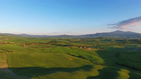 toscana : Tuscany aerial landscape of farmland hill country at evening. Italy, Europe, 4k Stock Footage