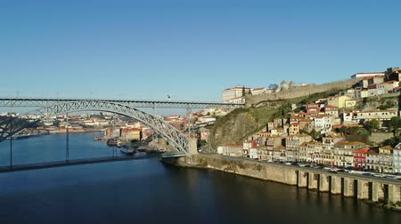 dom : Aerial view of Dom Luis Bridge and flying seagulls in Porto at morning, Portugal, 4k Stock Footage